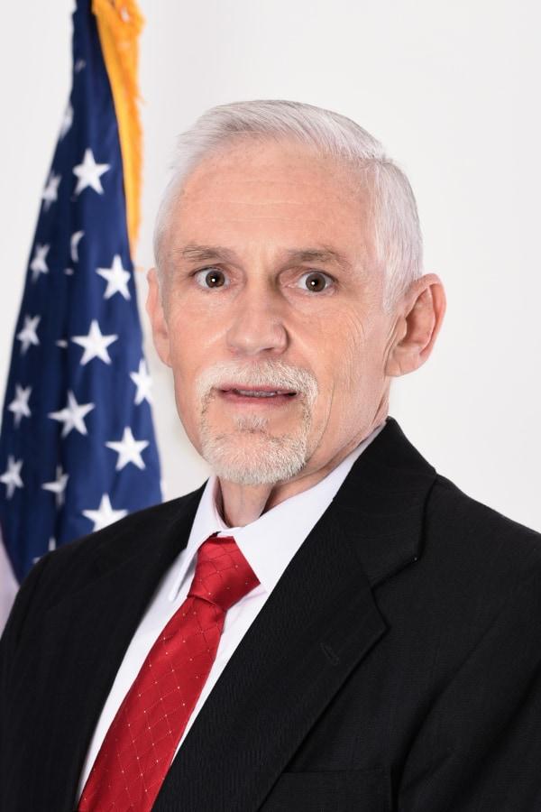 headshot of director of business development Ken Cromes